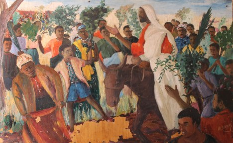 palm-sunday-an_african_jesus_christ_s_triumphal_entry_into_jerusalem_riding_on_a_donkey_to_the_enthusiasm_of_the_crowds.jpg